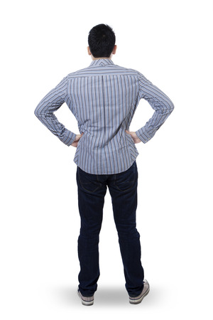 indian male: Backside view of young man isolated on white background