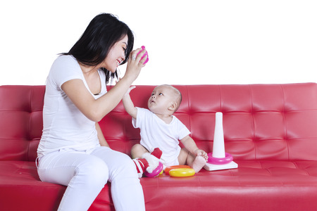 Asian mother and baby playing toys isolated on a white background photo