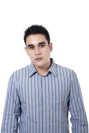 Portrait of seus asian man expression isolated on white background Stock Photo - 22622499