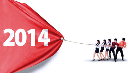 New future business concept with business teamwork pulling number of 2014 photo