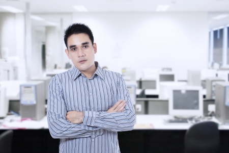 serious businessman: Young asian businessman confident with arms crossed looking at camera Stock Photo
