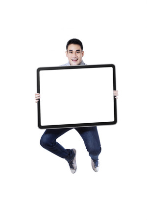 Excited asian man jumping with blank sign isolated on white background photo