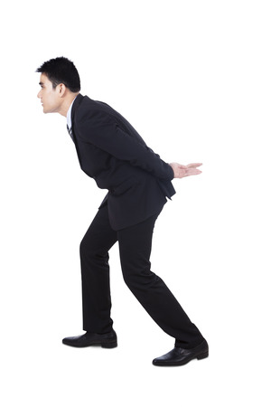 Business man carrying something on his back - isolated over a white  photo