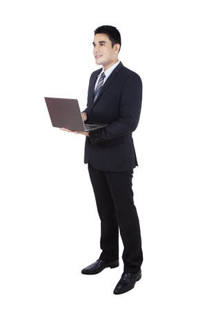 Asian businessman using laptop isolated on white photo