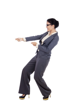 black pants: Businesswoman is pulling something on copy space