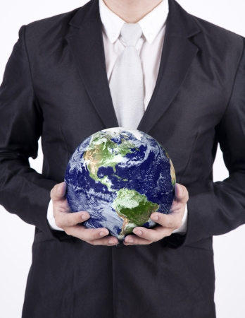 environmental suit: Businessman holding a globe isolated over white background. Confident asian businessman holding the planet earth isolated over white background. Earth image courtesy NASA