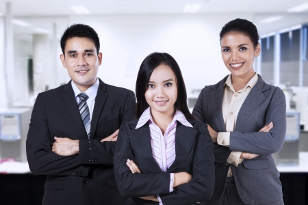 malaysian people: Confident business people looking at camera smiling. shot at office