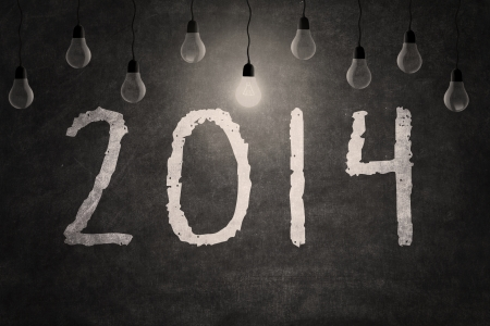 New year 2014 text with light bulb on blackboard Stock Photo - 22705064