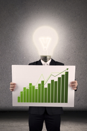 Businessperson with lightbulb head showing a bar chart photo