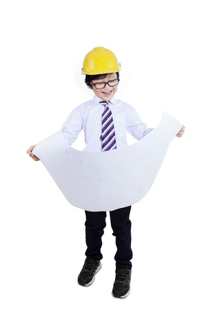 Little asian boy with blueprints isolated on white background photo
