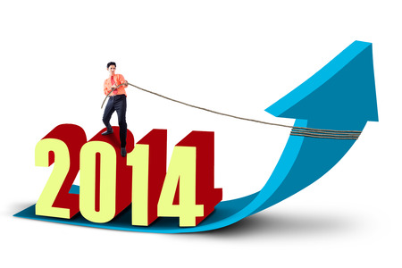 growth enhancement: Asian businessman is pulling the new year 2014 with chain on arrow sign