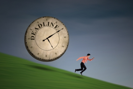 employe: Asian businessman is running with a big clock with writing: deadline Stock Photo