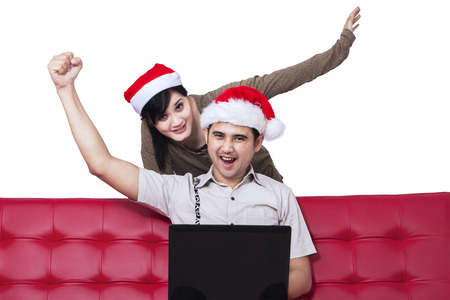Portrait of successful young christmas couple. isolated on white  photo