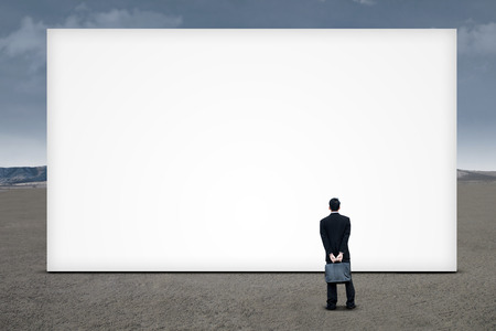 Businessman looking at a huge copy space Stock Photo - 23669664