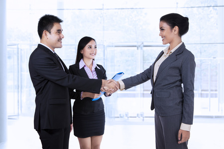 greet: Business partners making an agreement at modern office