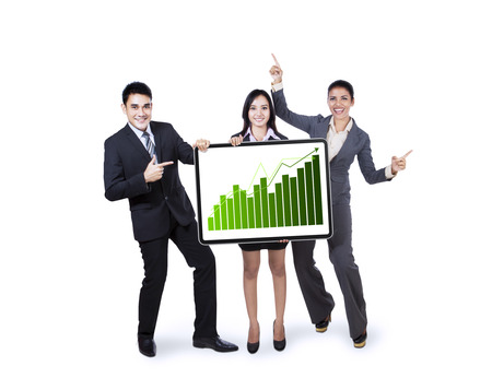 Excited business team holding a board with growth graph isolated on white  photo