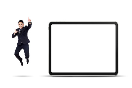 businessman jumping: Excited asian businessman jumping with empty billboard isolated on white
