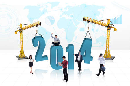 Business people is building the new year 2014 with blue map  photo