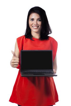 Happy casual woman showing a laptop screen photo