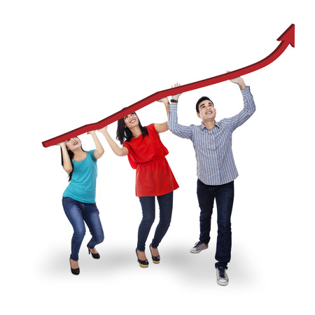 Group of people holding an arrow rising isolated on white  Stock Photo