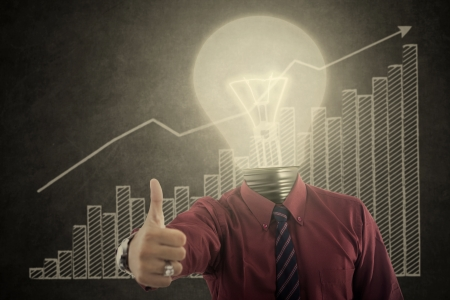 growing up: Bulb head businessman showing thumb up with growing graph