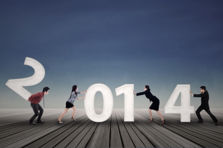 New business arrangement concept with bussinesspeople arrange new year of 2014 photo