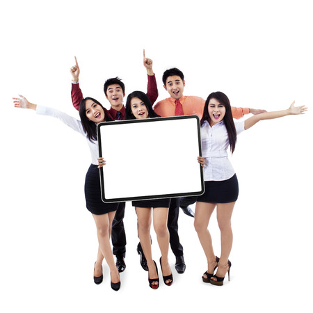 Successful business team showing empty board on white background photo