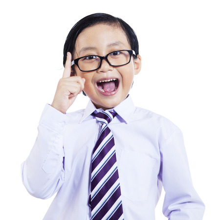 Cute asian schoolboy having an excellent idea, isolated on white background photo