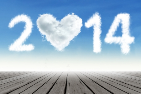 Heart shaped cloud of new year 2014 on the blue sky photo