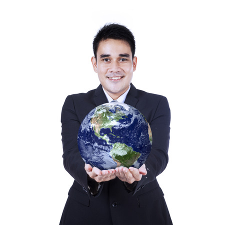 lifting globe: Happy businessman holding a globe, isolated on white background