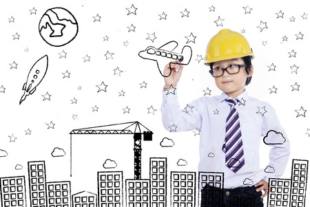 asian business people: Little businessman drawing on imaginary board Stock Photo