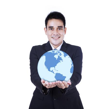Smiling businessman holding a globe, isolated on white background photo