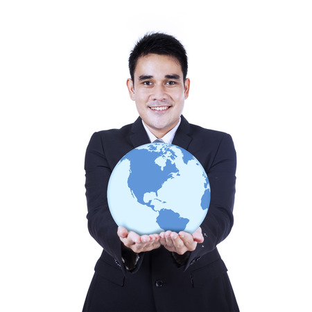 lifting globe: Smiling businessman holding a globe, isolated on white background Stock Photo