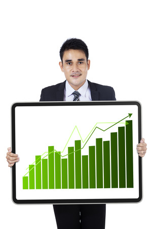 Young asian businessman showing board with growth graph photo