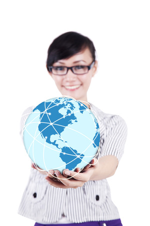 hand holding globe: Young businesswoman holding the earth isolated on a white background