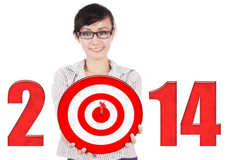 dartboard: Happy businesswoman showing a dartboard with year 2014 Stock Photo