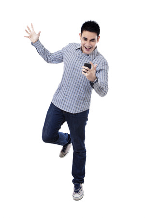 Happy asian man with mobile phone, isolated on white background Stock Photo - 23521136
