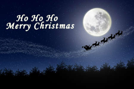 nightime: Santa and reindeer flying through the night sky Stock Photo