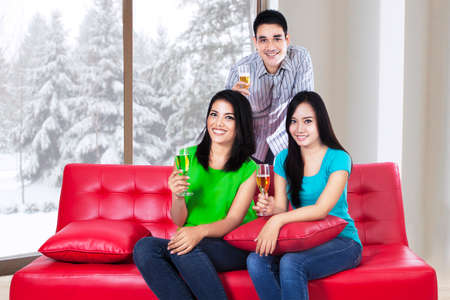 chinese drinks: Group of young people drinking champagne in winter season