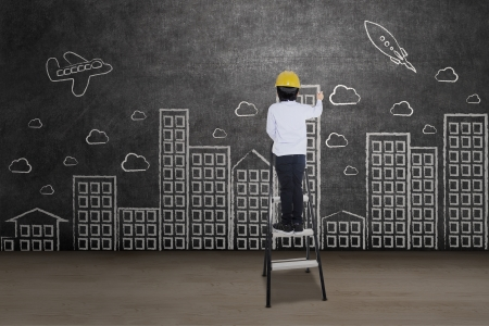 company building: Businessman drawing cityscape standing on a ladder