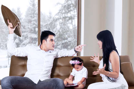Parents fighting in front of their daughter Stock Photo - 23729919