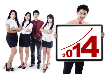 Group of business people showing the new year 2014 photo