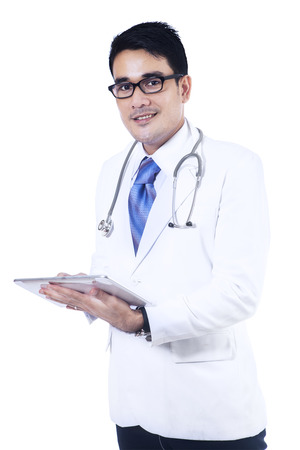 filipino: Portrait of male doctor is writing a prescription isolated on white