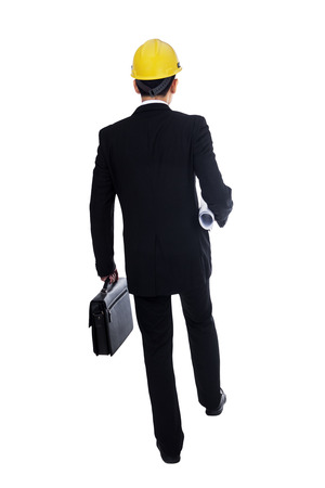 Back view of businessman holding a briefcase and walking forward on white background photo