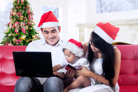 Happy christmas family using laptop computer at home photo