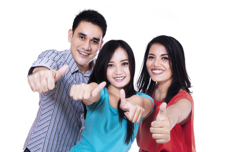 thumbs up sign: Group of happy friends giving thumbs up - isolated on white background