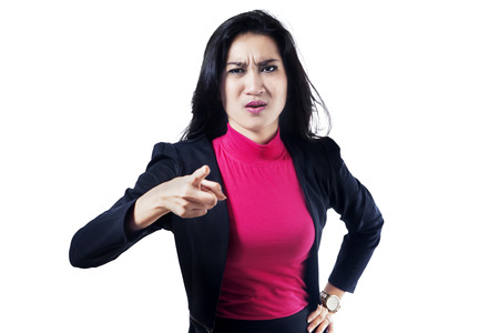 Angry business woman or boss screaming and pointing at camera photo