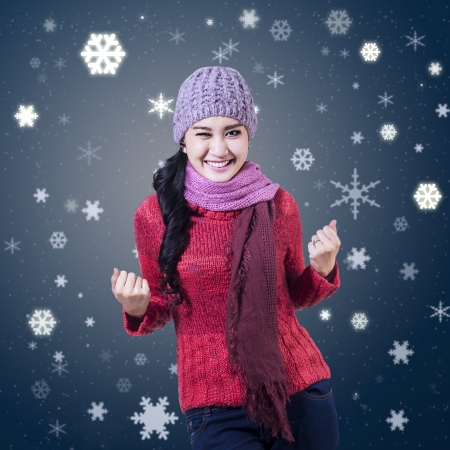 cheer up: Portrait of happy winter girl with snowflakes background Stock Photo
