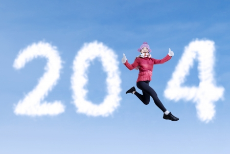 New year concept with young woman jumping among the word 2014