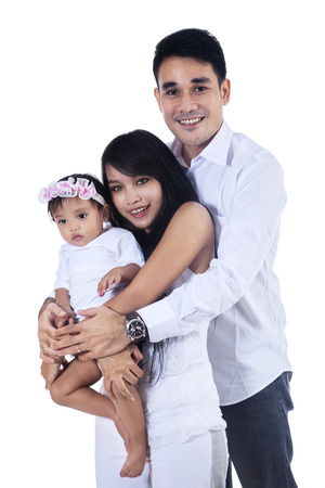 Portrait of happy smiling family isolated on white background Stock Photo - 24521375